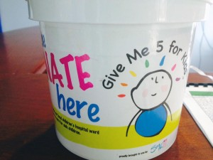 SeaFM office donation bucket.
